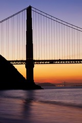 Bridge Tower Silhouette (Karen Kaner Photography) Tags: longexposure bridge tower beach nature water silhouette sunrise landscape bay colorful surf pacific cove tide marin shoreline goldengatebridge baybridge marincounty sanfranciscobay lowtide marinheadlands kirbycove ggb eastbaybridge goldengatebridgetower canon5dmkii kanerphotography goldengatebridgesilhouette