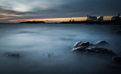 Blue water (- David Olsson -) Tags: longexposure blue winter sunset lake seascape cold industry nature water clouds landscape nikon rocks factory sundown cloudy sweden outdoor stones smoke tripod january le chimneys vnern storaenso dx hammar vrmland 1635 ndfilter 1635mm lakescape skoghall 2013 2exposures d5000 manualblend flickroid manuallyblended davidolsson nd500 lightcraftworkshop 1635vr skoghallsbruk grytudden skoghallverken