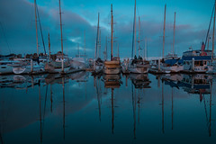 Pacific blue (Tazmanic) Tags: boats sailboats water pacific ocean seasky clouds masts flag sandiego california
