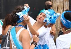 Getting dressed (lgh75) Tags: theparisphotographymeetupgroup lavagedelamadeleine festival parade brsil brasil colorful color samba music paris dancers danceurs danse