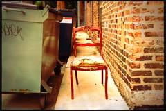 (234/366) Still Standing for Sitting (CarusoPhoto) Tags: hipstamatic juan rasputin apollo alley chair odd strange john caruso caruosphoto photo day project 365 366 iphone 6 plus berwyn il illiinois dumpster mundane banal ordinary everyday
