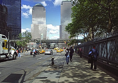 World Trade Center New York City (Patricia Speck) Tags: street newyorkcity light shadow people tree cars fence walking worldtradecenter towers taxis vehicles tricia patricia speck yellowcabs