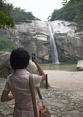 North Korean Woman Taking Picture Of Kaesong Waterfall, Kaesong, North Korea (Eric Lafforgue) Tags: camera color colour tourism vertical modern asian waterfall women war asia day technology womanonly cellular korea mobilephone asie guide rearview coree oneperson northkorea onepeople 20s lifestyles headandshoulders dprk coreadelnorte takingpicture outsdoors onewomanonly northkorean nordkorea 1people democraticpeoplesrepublicofkorea 북한 onlywomen 北朝鮮 корея coreadelnord 조선민주주의인민공화국 img5830 северная insidenorthkorea 朝鮮民主主義人民共和国 rpdc βόρεια haeso coreiadonorte เกาหลีเหนือ