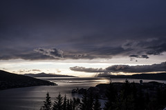 Any Port in a Storm (Espen Dalmo) Tags: sunset sea mountains norway clouds landscape harbor ship vessel narvik lightrays