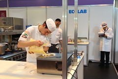 Hospitality show chef competition (tedesco57) Tags: show uk ice birmingham baker cream competition chef moment maker hospitality pouring mixture koch patissier cuisinier backer cuiszen