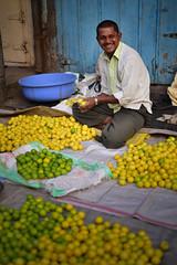 The Lemon Man (Josh Niederauer) Tags: india pune man lemon lime yellow fruit market street smile maharashtra indian