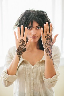 Henna hands frame face