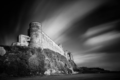 Bamburgh Castle Clock Tower from below (Andrew S. Gray) Tags: longexposure blackandwhite clouds movement clocktower northumberland bamburgh bamburghcastle 2013 andygray andrewsgray