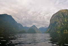 Doubtful Sound (planktons) Tags: new blue camping trees newzealand summer sky sun mist mountain mountains reflection green nature water clouds forest rainforest peak sunny cliffs zealand jungle kayaking nz sound fjord geology wilderness peaks kiwi doubtful fiord fjords doubtfulsound fiords fiordland fiordlands hallarm commanderpeak