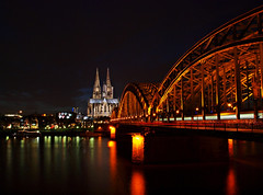 Most fotografed view of Cologne:  The Hohenzollernbridge with the Cologne Cathedral and the Philharmonic (Andy von der Wurm) Tags: city church water reflections river germany town wasser europa europe nightshot cathedral dom kirche cologne kln stadt alemania nrw fluss rhine rhein allemagne koeln soe strom nordrheinwestfalen philharmonic nachtaufnahme philharmonie langzeitbelichtung reflektionen koelle klle longtermexposure hohenzollernbruecke northrhinewestfalia hohenzollernbrcke hohenzollernbridge hobbyphotograph mywinners abigfave anawesomeshot diamondclassphotographer flickrdiamond platinumfoto damniwishidtakenthat 100commentgroup dragondaggerphoto ringexcellence tplringexcellence ruby5 andreasfucke andyvonderwurm