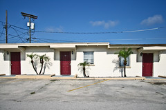 3 Palms (TW Collins) Tags: rooms shadows florida motel powerlines palmtrees reddoors centralflorida polkcounty lakealfred us92 us17 utilitypoles 3palms lakealfredmotel