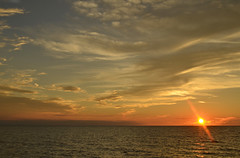 Clouds Dance with the setting sun August 2016 Michigan (wildrosetn39) Tags: august2016 lakemichigan clouds sunset water west horizon light