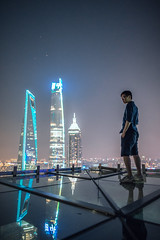 Portrait of young man standing on the rooftop (HIKARU Pan) Tags: portrait rooftop outdoors man shanghai china asia shanghaiworldfinancialcenterswfc jinmaotower shanghaitower lujiazui reflection chinese light night evening 24l canonef24mmf14liiusm 1dx eos1dx city landmark photography vertical wideangle
