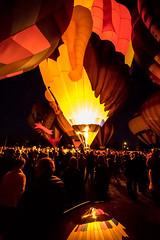 With Reflection (djking) Tags: alberta canada heritageinninternationalballoonfestival highriver crowd hotairballoons night reflection