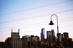 (coreykoeb) Tags: skyline downtown minnesota minneapolis kodakultra400 canonfx canon 35mmphotography 35mmfilm 35mm mn stonearchbridge film city goldmedalflour millcity