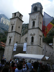Kotor, Montenegro, church in city square (rossendale2016) Tags: ring chimes bells bell twin two glass stained window rose flag stone tall old tallstone time hands fingers steeple tower clock square city church montenegro kotor
