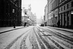 keep it coming (ewitsoe) Tags: street old city winter snow streets cold weather 35mm buildings walking 50mm nikon seasons pavement tracks poland snowing snowfall oldtown poznan wintery d80 staryreynik padarewskiego