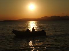 Evening Fishing at Lazise (Steve Barowik) Tags: italy lake holiday lago boat garda italia fuji view harbour finepix vista lungolago veneto lazise f100fd barowik stevebarowik sbofls26