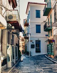 a street in Navplion, Greece (L F Ramos-Reyes) Tags: street travel architecture buildings greece balconies ironwork stores navplion lionfrr mygearandme