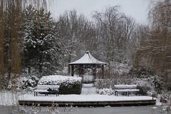 Chinese garden (CobaltWildlife) Tags: winter snow tree ice water garden bench landscape town pond woods miltonkeynes shed places naturalhistory campbellpark 2013