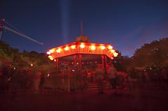 Lantern-Lit Gazebo (puting bagwis) Tags: longexposure red people motion blur festival crane gazebo event lanterns bluehour lightbeam aucklandlanternfestival putingbagwis aaronsalazar