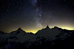 Stars Over Surprise (justb) Tags: sky mountain lake mountains silhouette yellow night vancouver canon way stars hope glow bc harrison peak traverse clear needle 7d surprise peaks milky cairn breakenridge justb