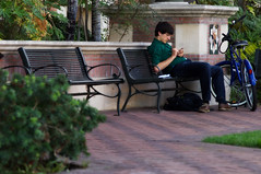 Student with Cell Phone (USC | University of Southern California) Tags: music sports students campus walking phone cell southern biking hanging usc volleyball studying center tutor california out university learning friends ronald quistorf students