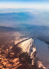 Fuji Sunrise - Aerial perspective (Hendrik Schicke) Tags: travel blue sky mountain snow mountains nature japan clouds plane canon airplane landscape photography flying amazing colorful fuji earth top air awesome horizon summit fujisan 5d rare canonef2470mmf28lusm birdseyeview mtfuji birdseye fujiyama beautyful birdsview aerialperspective highangleshot birdseyeperspective canon5dmarkii hightangle hendrikschicke
