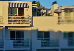 Too Darn Hot (MPnormaleye) Tags: heat focus bokeh blur soft lensbaby sweet35 utata resort hotel awning windows people deck summer umbrella terrace