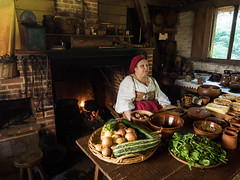 17th Century cook (Spinnakertog) Tags: littlewoodham museum gosport england unitedkingdom gb 17th century costume reenactment cook hearth fire cottage food table portrait fireplace woman lady house inside indoors