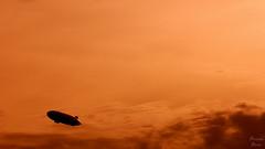 Kashmir (PhotonenBlende) Tags: zeppelin sky clouds silhouette lakeconstance bodensee himmel abstact art sunset orange outdoor nikon d80