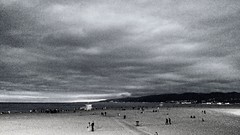 Santa Monica Beach BW (brev99) Tags: droidturbo landscape cameraphone photoshopelements12 blackandwhite perfecteffects10 ononesoftware california beach sand people clouds cloudy noise latelight santamonica