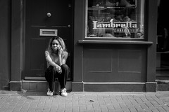Lambretta (Cliff.j) Tags: street candid girl smoking break lambretta carnaby london city outdoor eye contact step shop entrance tattoo front phone call trainers sony a7 carl zeiss bw cigarette