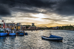 Evening At The Quay (robinta) Tags: waterfront harbour boats transport fishing river quay sea bridge architecture buildings ks1 pentax sigma18200mmhsmc sunderland sky clouds brooding moody reflections water