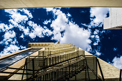 Stairs (chrisxmichael) Tags: building sky blue clouds stairs low point view