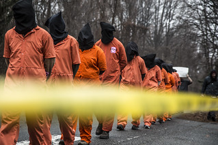 Witness Against Torture: Detainees and Police Tape