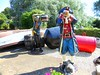 Pair of Posing Pirates. (davidezartz) Tags: uk greatbritain pink flowers blue trees light red two england sky people brown white black green hat leaves sunshine yellow scarf grey boat belt nikon shadows boots display barrels pirates pair coat posing statues telescope isleofwight ropes bushes buckle figures iow s4000 thegalaxy nikonstunninggallery platinumheartaward flickrestrellas ilovemypics gününeniyisithebestofday quarzoespecial however~itsstillmylife bealivebetopbeseven mygearandme nikons4000 ringexcellence nikoncoolpixs4000 rememberthatmomentlevel1 theshipwreckcentre
