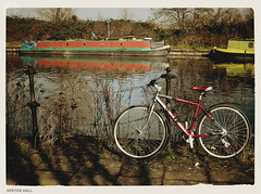 Red Bike Red Boat (peterphotographic) Tags: uk red england reflection london bicycle canon boat canal britain lea narrowboat walthamstow towpath eastlondon leavalley leevalley riverlea g12 canong12 caemarabag2