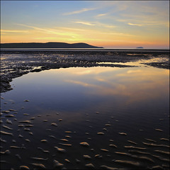 Ripple in Still Water  (: Explored :) (Pixelsuzy) Tags: uk greatbritain sunset england reflection beach water silhouette canon puddle seaside sand mud unitedkingdom britain wideangle somerset riversevern filter ripples westonsupermare northsomerset wsm southwestengland 3stop westonbay northsomersetcoast lee06gradfilter pixelsuzy