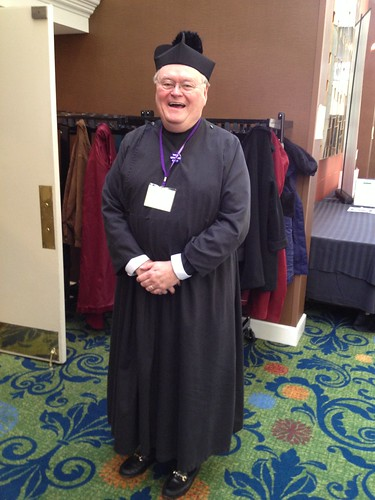 <p>The Rev. Corky Carlisle joyfully donned a tippet and cassock after more than $2000 was raised for Sewanee by those he disparaged for their attire.</p>