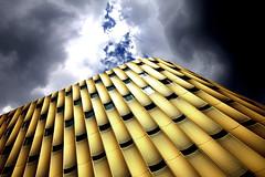 Go for Gold (Mastahkid) Tags: mastahkid utrecht nederland niederlande thenetherlands parkhaus fassade facade gold fenster windows lcher holes himmel sky wolken clouds sonne sun dramaticsky ontourwithmyego