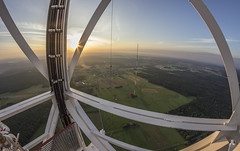Almost there (AnotherStepAway) Tags: urbex urban exploration urbanexploration high height roof rooftop rooftopping exploring explorer sky night antenna radio tower steel metal huge lights adventure sunrise orange white red