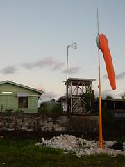 Orange Windsock (mikecogh) Tags: tuvalu funafuti windsock orange drooping rubble calm still