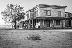 Tumbleweed In Old Western Town (Michael C. Jensen) Tags: blackwhite bw western movie town tumbleweed sunrise hangingtree weathered new mexico