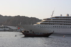 Sunset at the port (RadioKate) Tags: oman oman2016 travel travelogue port muscat sunset sun boat boats cruiseship dhow