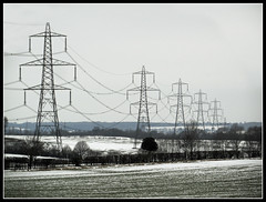 Winter Pylons (Jon 89) Tags: uk trees winter england sky white snow cold tower ice field lines weather electric metal skyline danger rural walking landscape photography grey countryside frozen vanishingpoint big frost track pattern power view britain near snowy path walk farm live united country great towers large structures freezing kingdom scene row farmland structure line pylon trail photograph freeze crop link gb electricity letchworth fields bleak crops tall temperature february pylons hertfordshire willian towering 2012 supply publicfootpath herts braycottages