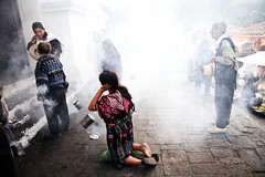 The steps of Iglesia Santo Toms on market day in Mayan town Chichicastenango, Guatemala (eriktorner) Tags: lake church volcano boat highlands fisherman cathedral maya market guatemala religion praying steps mayan offering fisher kneeling cowboyhat incense chichicastenango