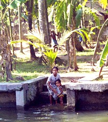 Bathing in Kerala Backwaters (bokage) Tags: woman india bath village child kerala backwaters