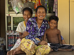A Cambodian family (BenDem) Tags: world family boy portrait people girl smile face shop proud kids female rural children asian happy asia cambodia cambodian looking outdoor young parent malaysia cheerful phnom penh