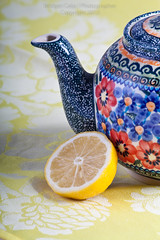 Fresh Cut Lemon With Teapot Decorated With Red and Blue Flowers-1564-2 (Bridget Calip) Tags: flowers hot ceramic lemon tea fresh half teapot citrus organic acidic afternoontea redflowers wedges blueflowers breakfasttea bridgetcalip